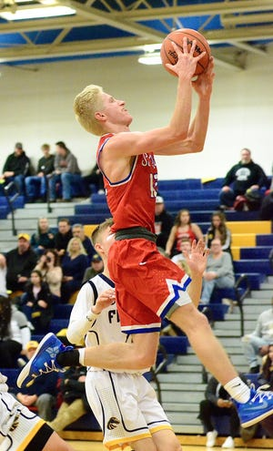 St. Clair's Matt Buslepp attempts a layup during a Macomb Ace-Gold boys basketball game on Thursday, Feb. 13, 2020, at Fraser.