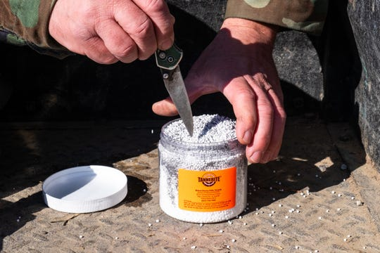 Pete Galante, president of Blue Water Sportsman Association, mixes the components of Tannerite Friday, Feb. 14, 2020, at one of the club's rifle ranges. Brockway Township is developing an ordinance that would regulate some use of materials like Tannerite in target-shooting.