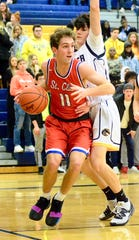 St. Clair's Jared Liniarski drives to the basket during a Macomb Ace-Gold boys basketball game on Thursday, Feb. 13, 2020, at Fraser.