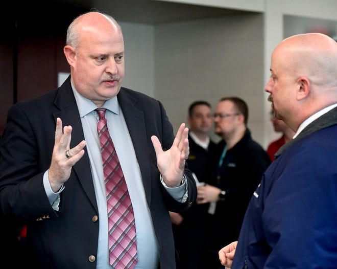 Matthew Hobson, the new director at the York County 911 Center, talks with Chris Krichten, director of safety and emergency management for WellSpan, at a meet-and greet for Hobson at the center Friday, Feb. 14, 2020. Hobson started the job Feb. 10. Bill Kalina photo