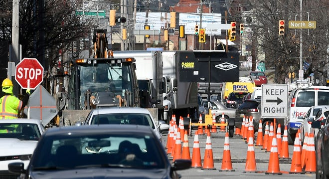 Traffic moves southbound through construction areas on North George Street Friday, Feb. 14, 2020. Bill Kalina photo