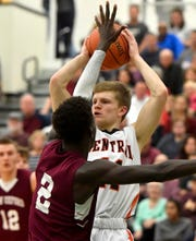 Central York's Nolan Hubbs shoots while covered by Abdul Janneh of New Oxford during the York-Adams boys' basketball championship, Thursday, February 13, 2020.John A. Pavoncello photo