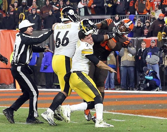 FILE - In this Nov. 14, 2019, file photo, Cleveland Browns defensive end Myles Garrett (95) hits Pittsburgh Steelers quarterback Mason Rudolph (2) with a helmet during the second half of an NFL football game in Cleveland. (Joshua Gunter/Cleveland.com via AP, File)