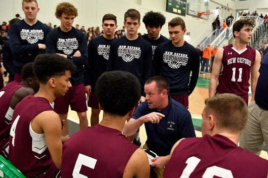 New Oxford boys' basketball coach Nate Myers talks to his team during the York-Adams League title game vs. Central York on Thursday, February 13, 2020. John A. Pavoncello photo