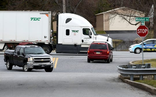 Traffic at the intersection of 11th Avenue and Whiteford Road Friday, Feb. 14, 2020. Bill Kalina photo