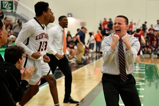 Central York coach Kevin Schieler celebrates as the Panthers won the York-Adams League boys' basketball title on Thursday night.