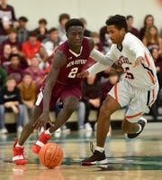 New Oxford's Abdul Janneh, left, is the York-Adams Division I Boys' Basketball Player of the Year.