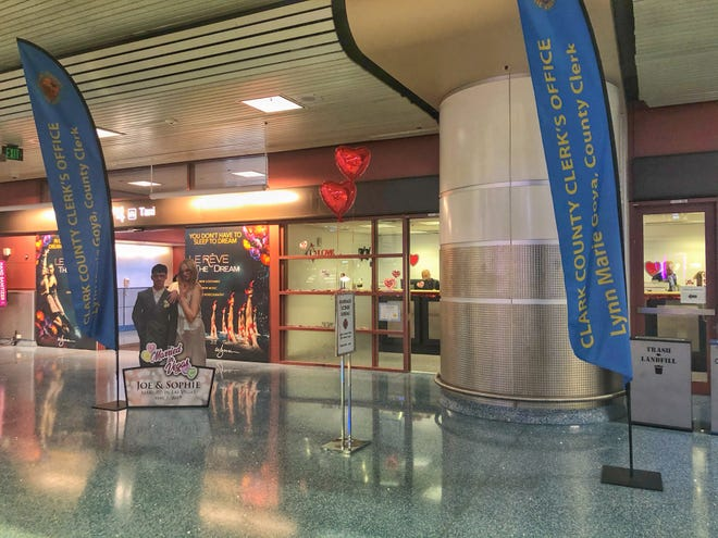 The Clark County Clerk's Office opened a temporary marriage license office in the Terminal 1 baggage claim area at McCarran International Airport.