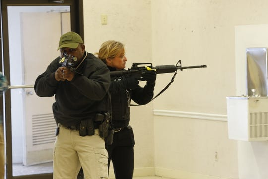 Richmond Police Department Officer Aaron Stevens and Detective Michelle Miller move into the former Elder-Beerman during an active-shooter training scenario Thursday.