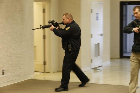 Major Jon Bales enters the former Elder-Beerman building during February's active-shooter training.