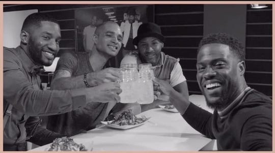 Joel James (left) and fellow comedians Zack Johnson and Travis Blunt make a toast with Kevin Hart during their appearance on his show.