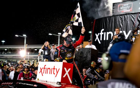Corning native Tyler Reddick celebrates at victory lane after winning his second consecutive NASCAR Xfinity title at Homestead-Miami Speedway on Nov. 16, 2019.