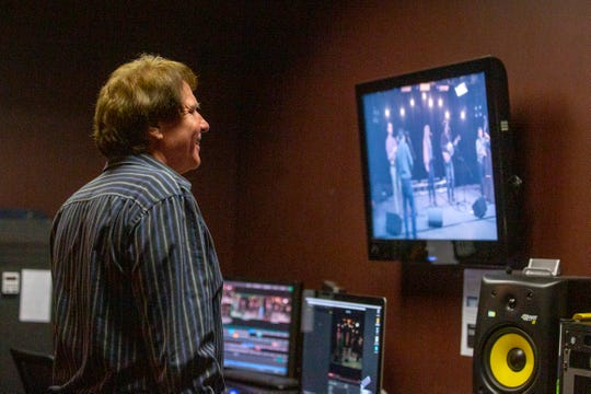 """Host Robert Richter watches Kristen Grainger & True North's performance during a taping for an episode of CCTV Music programÊ""""Local Roots"""" on Feb. 8, 2020 in Salem."""