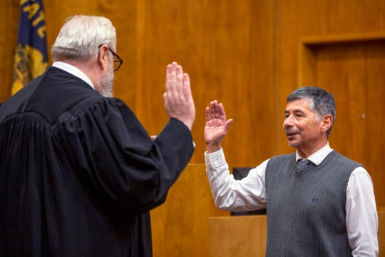 Marion County Judge Manuel Perez, former defense attorney, is sworn in to the Marion County Circuit Court by Judge Channing Bennett on Feb. 13, 2020.