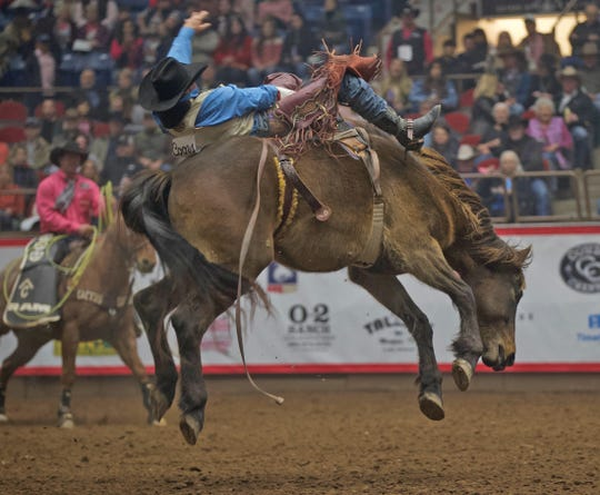 Nate S. Mcfadden competes in the bareback event during the San Angelo Stock Show and Rodeo on Thursday, Feb. 13, 2020.