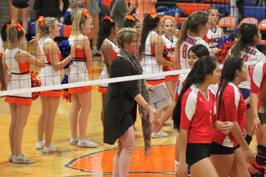 San Angelo Central High School head volleyball coach Connie Bozarth congratulates the opposing team after one of the Lady Cats' matches in 2017.