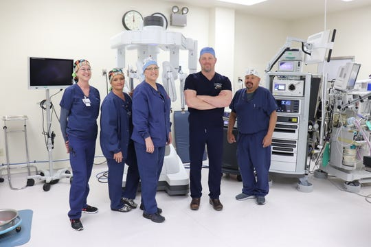 Community's advanced equipment gives surgeons, urologists and gynecologists the ability to perform minimally invasive surgeries, which can reduce patient time in the hospital and aids in a quicker recovery. Pictured are Patti Rader,  Shauna Ward, Tracy Sturdivant, Dr. Michael K. Boyd and Danny Flores.