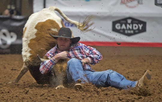 Mclane Arballo competes in steer wrestling during the San Angelo Stock Show and Rodeo on Thursday, Feb. 13, 2020.