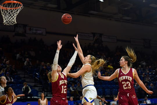 Tori Nelson of SDSU shoots the ball over the hands of Denver's Claire Gritt on Thursday, Feb. 13, at Frost Arena in Brookings.