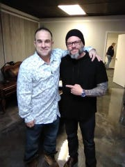John Stark (left) poses with  Pastor John Alarid of Freedom City Church in this 2018 photo. Stark's body was found Wednesday near the Veterans Coming Home Center, a drop-in center for homeless people. Police are investigating but say Stark's death does not appear to be suspicious.