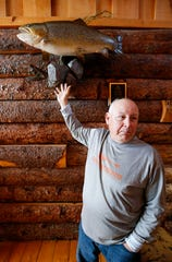 Bill Babler talks about the record-setting brown trout that he caught in Lake Taneycomo last year and that is now on display at the White River Lodge near Blue Eye that he runs with his wife.