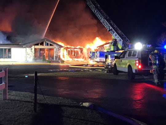 This photo from KOLR10-TV shows a fire destroying much of the Snapp-Bearden Funeral Home & Crematory on Thursday night.