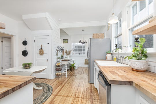 The Jeppsens knocked down a wall that originally divided the kitchen from a laundry room. It also allowed them space to put in a proper staircase. Previously, there was only a tiny spiral staircase leading to the attic.