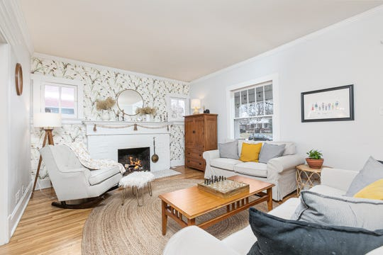 Jen selected a lively floral print for a living room accent wall and subtle pops of color elsewhere. She says she's drawn to a combination of yellows and grays.