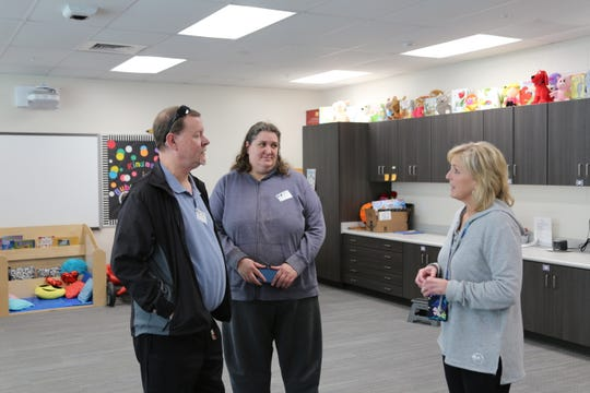 Left to right: Robert Jones, Jamie Jones and Patricia Buelte discuss how the Pumper Car has helped Robert and Jamie's son Robby. Buelte is a special education teacher at Cedar North Elementary School and works with Robby, who has autism and ADHD.