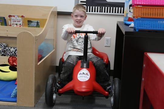 Robby Jones, 7, shows off his Pumper Car skills at Cedar North Elementary School on Feb. 12, 2020.