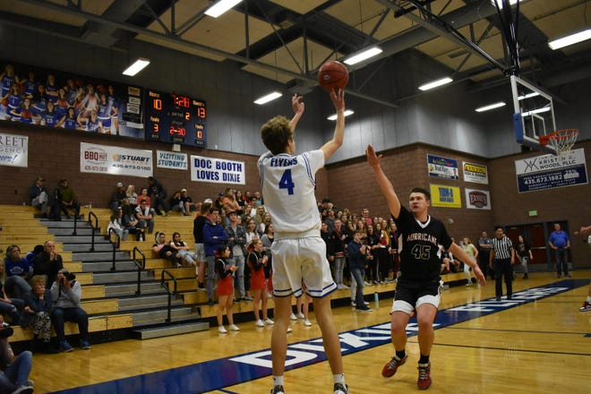 Dixie's Isaac Finlinson fires a 3-pointer against Hurricane.