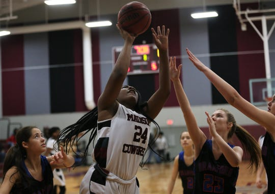 Madison County sophomore center Dakayla Hopkins goes up for a rebound-putback as the Cowgirls' girls basketball team beat Branford 71-35 in a Region 4-1A semifinal on Feb. 13, 2020.