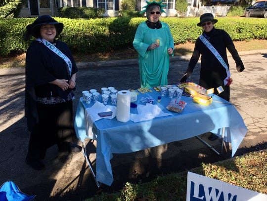 Members of the League of Women Voters hand out water at the 2020 Tallahassee Marathon.