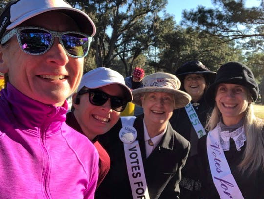 League of Women Voters members cheer on runners at the 2020 Tallahassee Marathon.