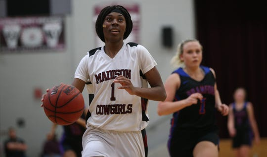 Madison County senior guard Lasage Ferguson races up the floor for a basket as the Cowgirls' girls basketball team beat Branford 71-35 in a Region 4-1A semifinal on Feb. 13, 2020.