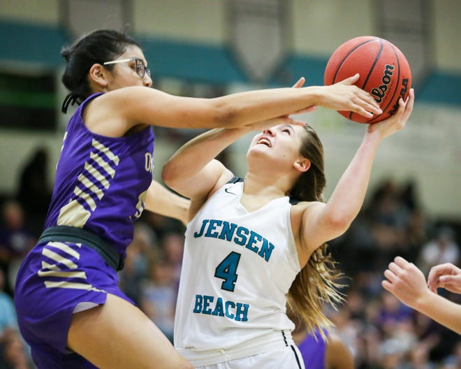 Jensen Beach's Lauren Cioffi (4) goes for a shot as Okeechobee defends during the first period in a girls Region 4-5A quarterfinal basketball game at Jensen Beach High School Thursday, Feb. 13, 2020, in Jensen Beach.