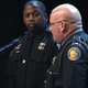 Riviera Beach police Detective Jemel Headings (left), who authorities say fatally shot a man who just had killed Florida Highway Patrol Trooper Joseph Bullock, is honored by FHP Major Robert Chandler at Bullock's funeral in Bradenton on Thursday, Feb. 13, 2020.