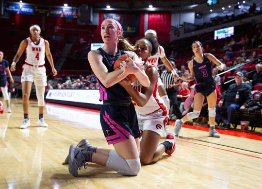 University of Texas El Paso freshman guard Avery Crouse looks calls for a timeout while trying to keep it away from Western Kentucky redshirt senior forward Sandra Skinner in the game against Western Kentucky at E. A. Diddle Arena on Thursday, Feb. 13, 2020. (Grace Ramey/photo@bgdailynews.com)