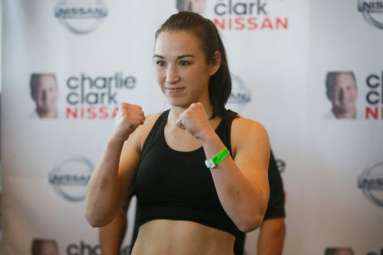 Main event fighter Jennifer Han weighs in Friday, Feb. 14, at Charlie Clark Nissan for the Feb. 15 boxing card at the El Paso County Coliseum in El Paso. Han will be boxing Jerri Sue Sitzes.