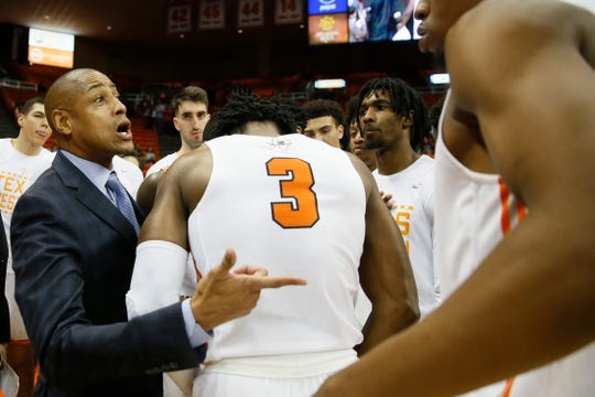UTEP head coach Rodney Terry talks to the team in a huddle during the game against Western Kentucky Thursday, Feb. 13, at the Don Haskins Center in El Paso.