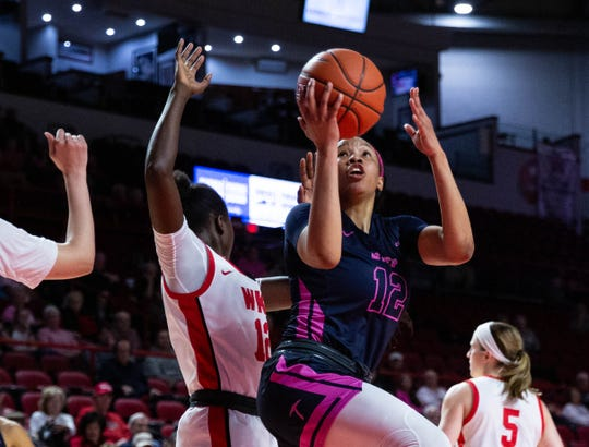 University of Texas El Paso senior forward guard Ariona Gill shoots a layup in the game against Western Kentucky at E. A. Diddle Arena on Thursday, Feb. 13, 2020. (Grace Ramey/photo@bgdailynews.com)