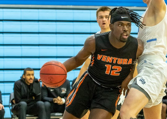 Ventura College sophomore Tone Patton drives around a defender in the Pirates' 89-81 win at Moorpark College on Wednesday night at Raider Pavilion.