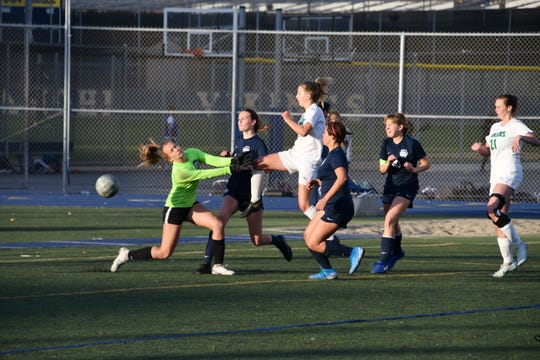 Sophomore Chloe Cole scores the Thousand Oaks High girls soccer team's first postseason goal in 11 years in Thursday's 3-1 loss at Santa Monica in the first round of the CIF-Southern Section Division 3 playoffs.