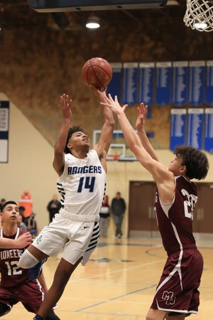 Redwood's Malachi Aguilar shoots against Mt. Whitney in a West Yosemite League high school boys basketball game on Thursday, February 13, 2020. The Rangers will play for a section title on Saturday at Selland Arena in Fresno.