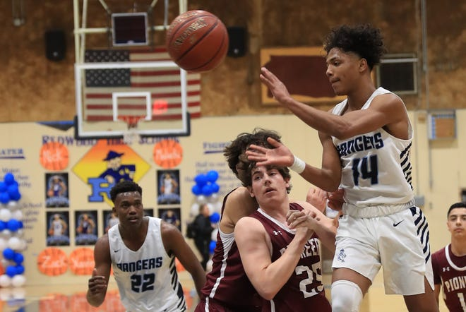 Redwood High's Malachi Aguilar, right, is the 2020 co-West Yosemite League boys basketball player of the year.