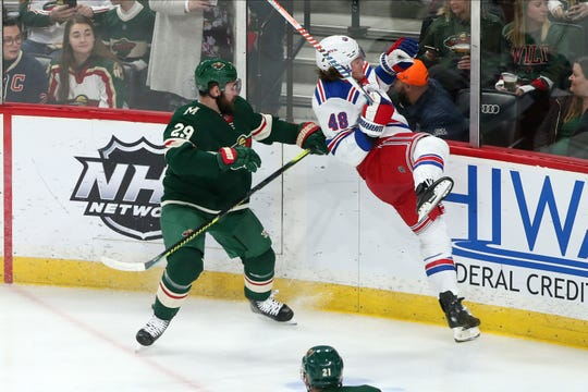Minnesota Wild's Greg Pateryn, left, checks New York Rangers' Brendan Lemieux during the first period of an NHL hockey game Thursday, Feb. 13, 2020, in St. Paul, Minn.