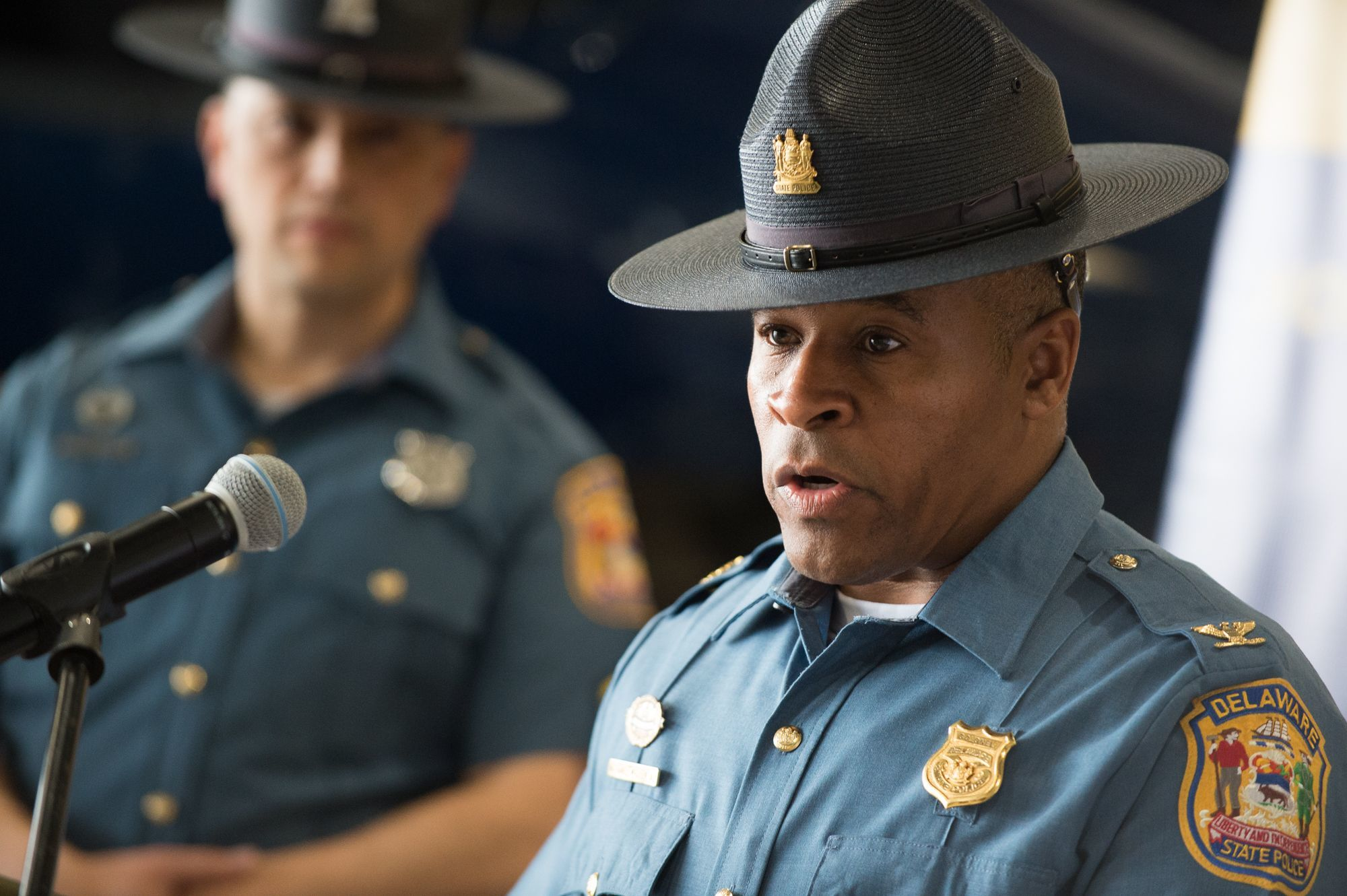Colonel Nathaniel McQueen, Jr., speaks during a press conference by the Delaware State Police.