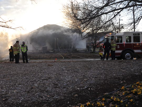 Wichita Falls firefighters work to control a early Friday morning house fire on Kemp Blvd.