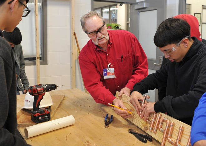 Wichita Falls ISD Career Education Center plumbing teacher Danny Cosby worked with a small group of students Friday afternoon.