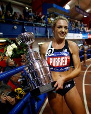 Elle Purrier holds a trophy after winning the NYRR Wanamaker Mile at the Millrose Games track and field meet Saturday, Feb. 8, 2020, in New York. (AP Photo/Adam Hunger)